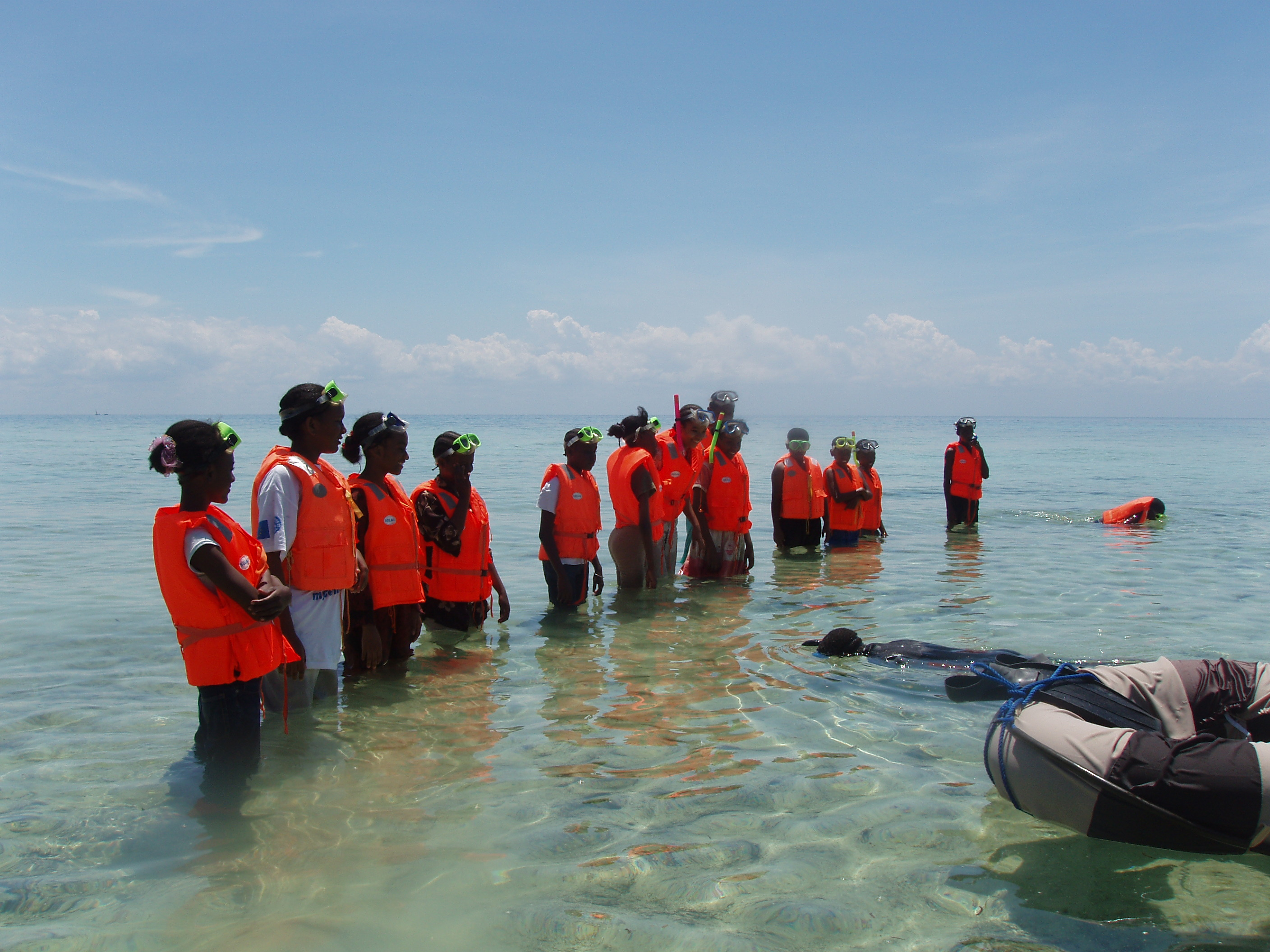 Zanzibari school children getting ready for snorkelling in the Chumbe reef