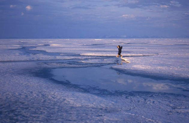 Inuit child jumping on ice, Pont Inlet, Canada. Photo: Peter Prokosch